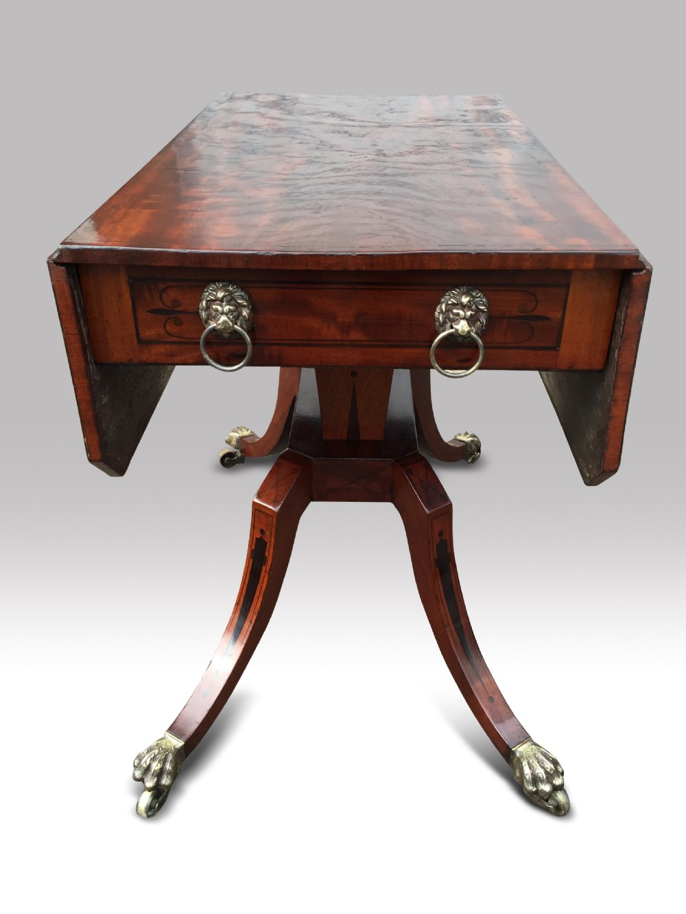 a fine regency mahogany and ebony inlaid drop leaf sofa table